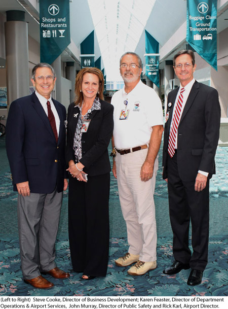 (Left to Right) Steve Cooke, Director of Business Development; Karen Feaster, Director of Department Operations & Airport Services, John Murray, Director of Public Safety and Rick Karl, Airport Director.