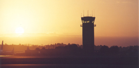 photo of the outside of the airport at sunset.